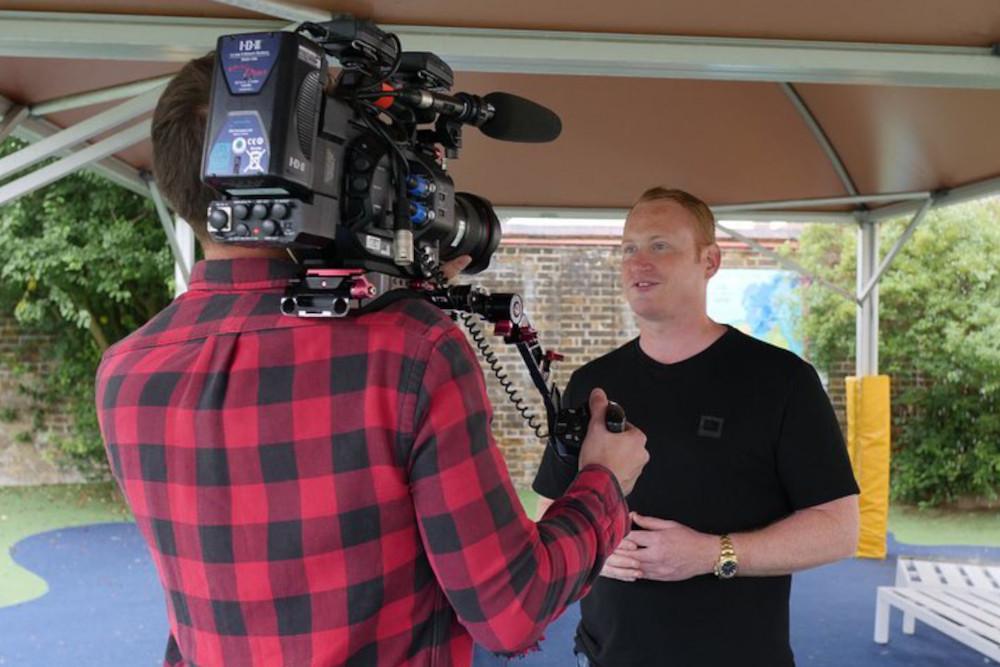 Adam Stott being interviewed