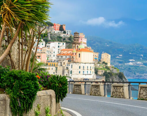 View of the Amalfi coast town, palm trees and road