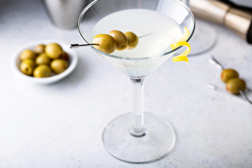 Classic lemon drop martini with olives and a lemon twist