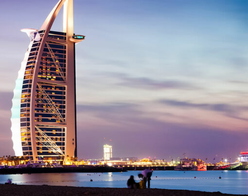 The world's first seven stars luxury hotel Burj Al Arab at night seen from Jumeirah public beach in Dubai, United Arab Emirates