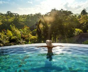 woman in swimming pool relaxing